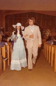Mr. & Mrs. David Matthews walking back up the aisle